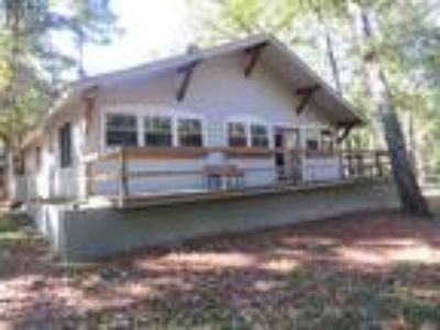Three BR/ Two BA/ 1600 SF on a wooded lot