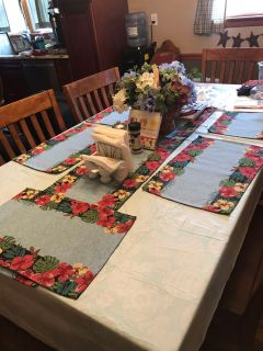 Six tapestry placemats and a table runner clean no stains!