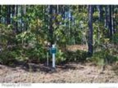 A beautiful wooded home site located on the ...