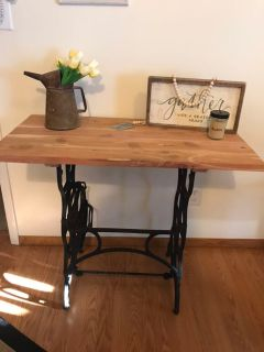 Cedar table made with cast iron sewing machine base