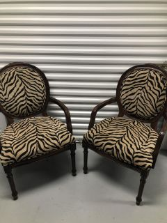 2 Accent Chairs Very Sturdy wood with padded seat and back. Excellent Condition.