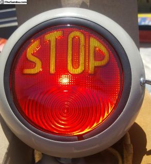 STOP light yellow letters