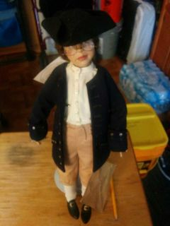 Benjamin Franklin doll with key and kite.