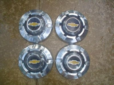 $150 OBO Vintage Chevy Bowtie Hubcaps