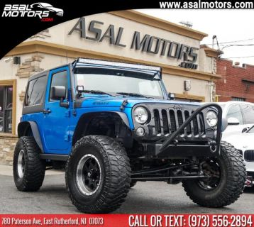 2015 Jeep Wrangler 4WD 2dr Willys Wheeler (Hydro Blue Pearl Coat)