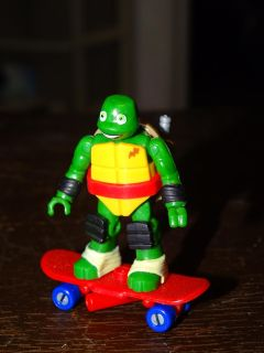 TINY NINJA TURTLE ON A SKATEBOARD, NO IDEA ON BRAND, MORE PICS IN COMMENTS