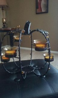 Pumpkin shape rod iron tea light candle holder. Roughly 33 in around the size of a normal basketball. Includes tea light candles. $8
