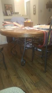 Solid wood and wrought iron table and 4 chairs