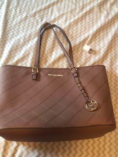 Mauve colored Michael Kors Purse