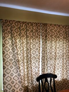 Tan burlap curtains with olive green design