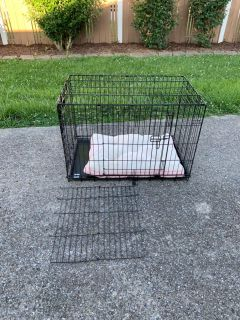 Medium sized dog crate with bed
