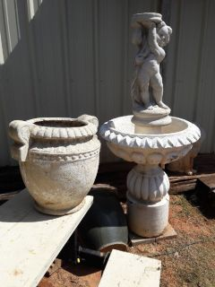 large concrete fountain, two urns