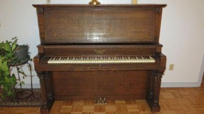 "1912 Armstrong upright Piano ""Cabinet Grand"" & glass claw-foot stool"