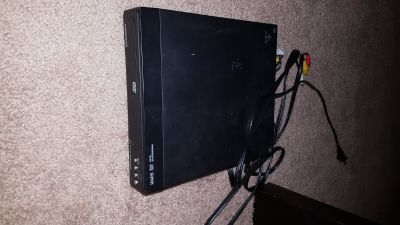 Magnavox DVD Player with charger cord and aux cords