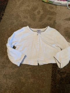 Carters 12m cardigan with navy trim - ppu (near old chemstrand & 29) or PU @ the Marcus Pointe Thrift Store (on W st)