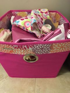 Bin of baby doll clothes