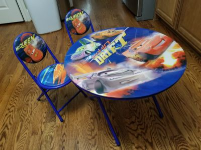 Disney cars folding table and chairs. Like new! All 3 pieces fold up for easy storage.