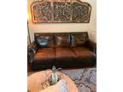 Excellent condition leather sofa and two chairs