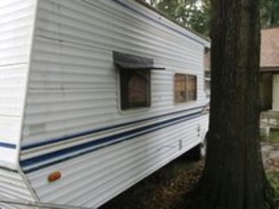 Early 2000 model Cherokee by Forest River bumper pull travel trailer