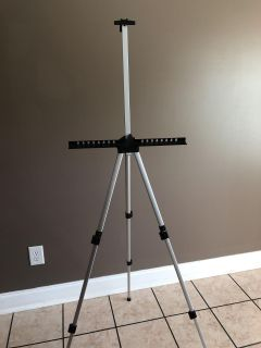 Easel telescopic extends from 35 to 62 , but folds up to 19