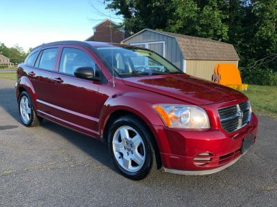 2009 Dodge Caliber SXT (Inferno Red Crystal Pearl)