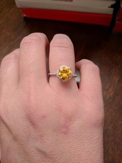 Sterling silver ring size 7. Cz on sides and around center stone. Center stone is yellow cz