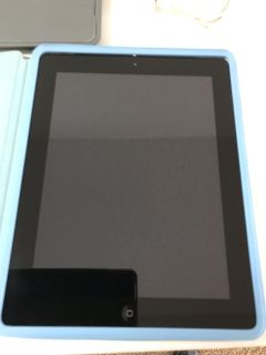 IPad 2 (with two cases and charger)