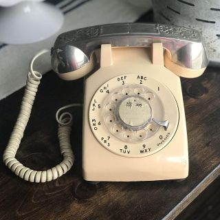 Vintage rotary-dial phone. Interesting southwestern silver metal relief/cover w/Initial R engraved on it. Mid century. Only $45!