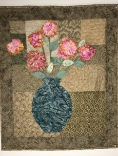 Quilted wall hanging with raised flowers