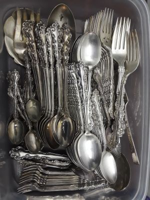 Two sets of silverware