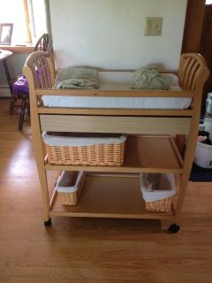 Changing table on locking wheels with pad and covers