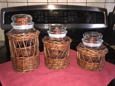 Set of wicker glass jar holders. Would be great and a bathroom! For all those little thing!