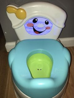Fisher price potty chair with lights, sounds and phrases