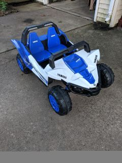 Kids motorized car. Barely used, works great! Comes with battery charger. Originally bought for $200