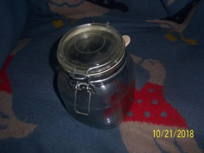 glass storage jar has rubber seal so seals tight with a snap lock hook