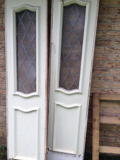 Front 3 panel solid wood door. One side stained other side painted