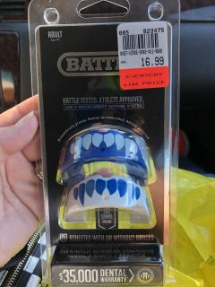 Football mouthpiece. New never used. My Husband bought for our son and when I got it out of the bag I realized he bought adult.