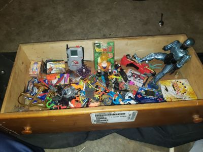 Multiple older action figures and weapons