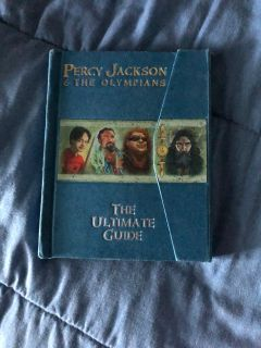 Percy Jackson. Hard back. Comes with collector cards