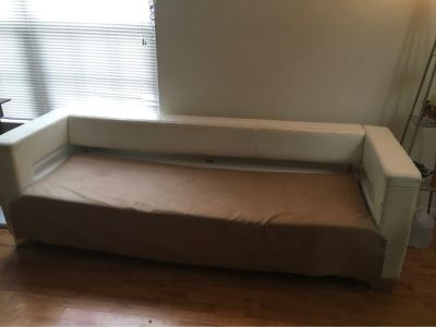 Leather White couch with pull out bed (needs refurbished)