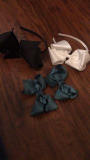 2 headbands (1 Black & 1 white) & 2 green bows with alligator clips