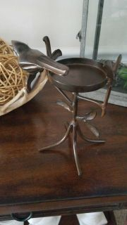 Metal candle holder with bird