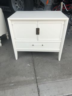 Cute table finished in antique white