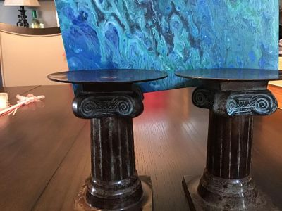 Pair of heavy metal pillar candle holders