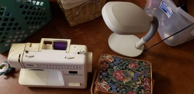 Brother sewing machine, craft light and sewing basket $100 all
