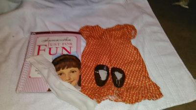 Vintage American girl dress shoes and tights and book.
