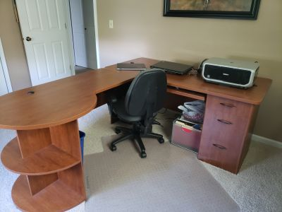 L shaped desk with book shelves, file cabinet and drawers