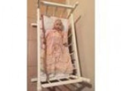 doll in crib (Northboro)