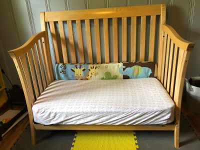 Great condition! Solid wood crib and toddler bed! Organic cotton mattress- only slept on about 5 times! LIKE NEW All hardware included.