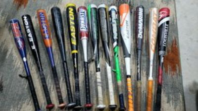 13 baseball bats variety of sizes